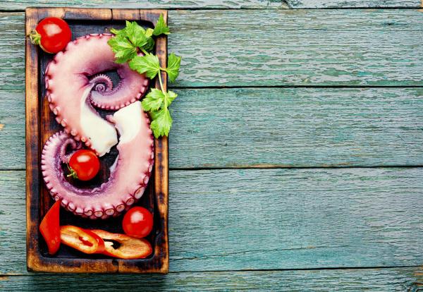 raw octopus on cutting board
