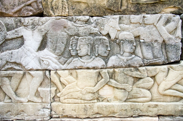 bas relief of seated men in