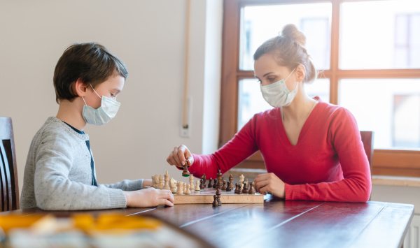 mother and son playing chess to