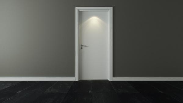 door under spot light with wall