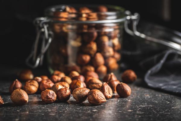 peeled hazelnuts on old kitchen table
