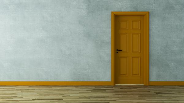 orange wooden door with concrete wall