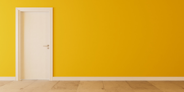 white wooden door with yellow wall