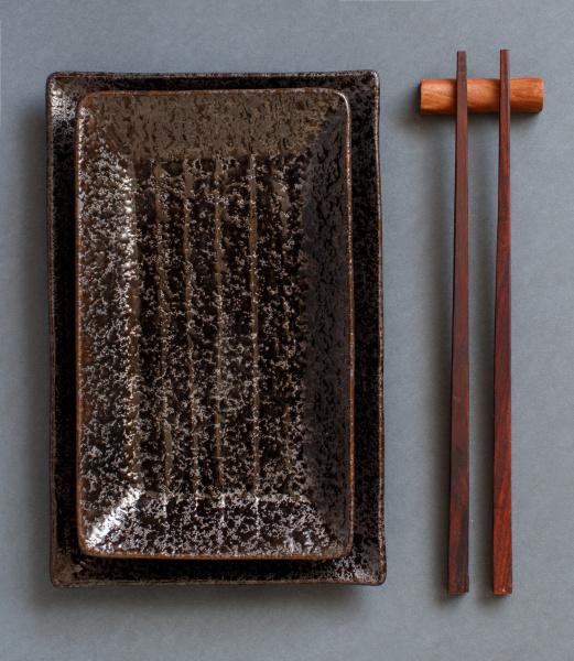 chopsticks, and, rectangular, plates, on, dark - 28218397