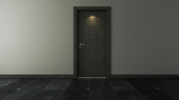 black wooden door under spot light