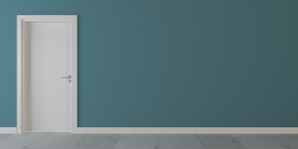 white wooden door with blue wall