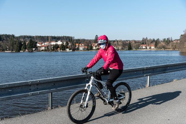 female biker with face masks on