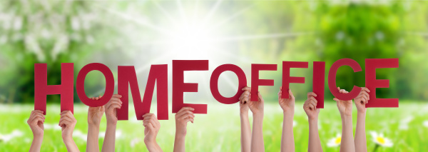 people hands holding word homeoffice grass