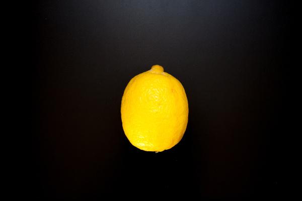 yellow lemon on black table food