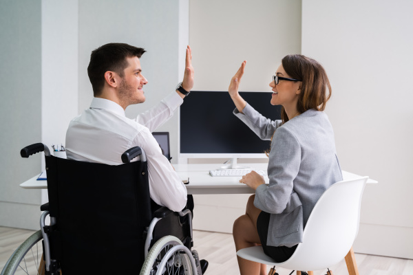 disabled, businessman, giving, high, five, to - 28237995