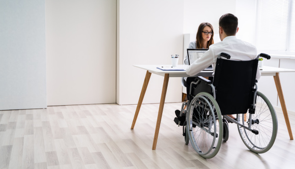 disabled, businesswoman, sitting, with, her, partner - 28238035
