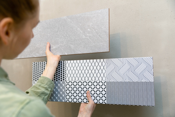 woman, choosing, wall, tiles, for, her - 28238552