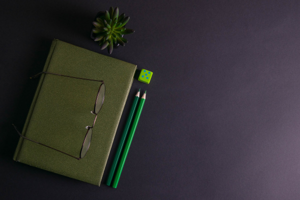a, green, notebook, with, glasses, on - 28239343
