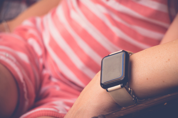 smartwatch, on, sitting, young, woman, hand - 28240143