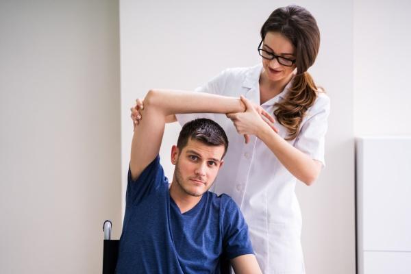 doctor showing rehabilitation exercise