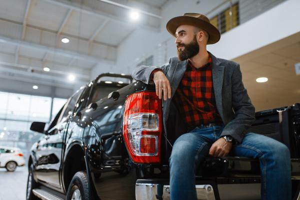 man in hat poses at pickup