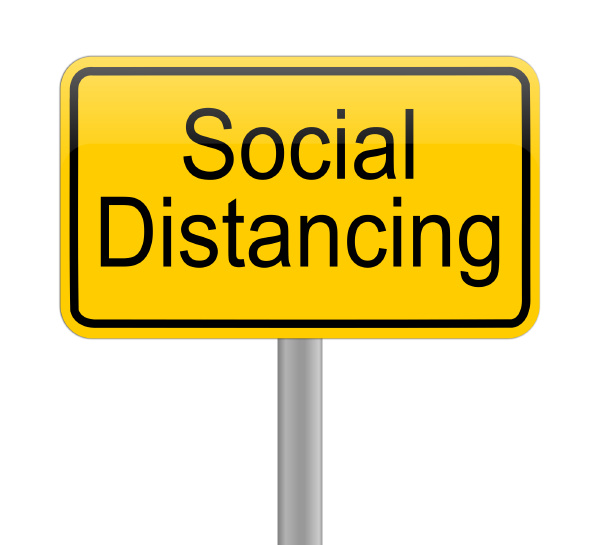 social distancing on yellow sign