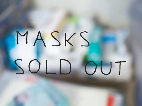 masks sold out sign blurred pharmacy