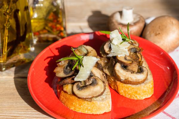 bruschetta with mushrooms on a wooden