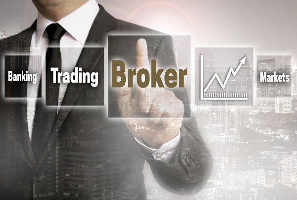 broker businessman with city background concept