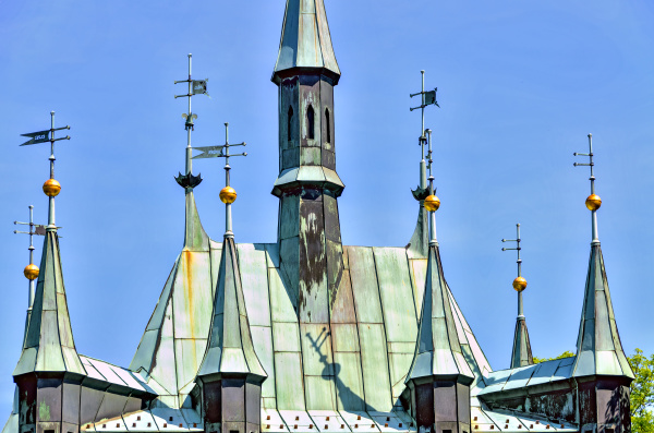 weather vanes on a historic building