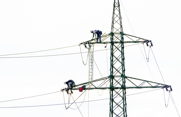 two workers on an electric pylon