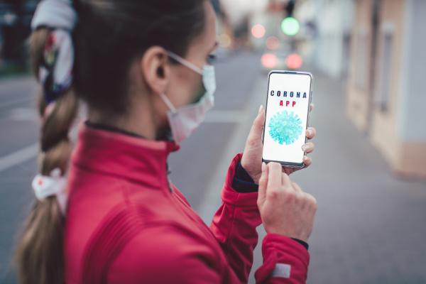 woman using phone with the coronavirus