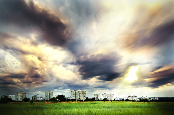 dramatic sky over city buildings
