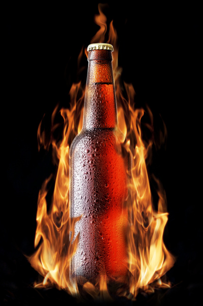 brown beer bottle in the fire