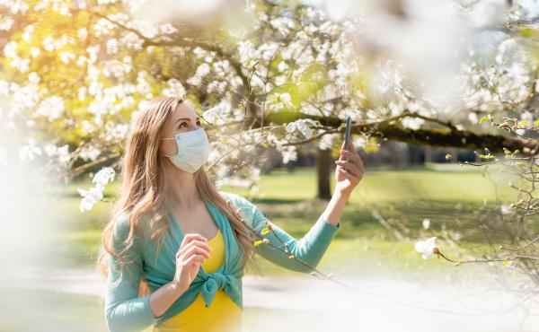 woman enjoying the spring blossom despite