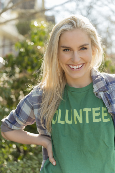 portrait of smiling woman in volunteer
