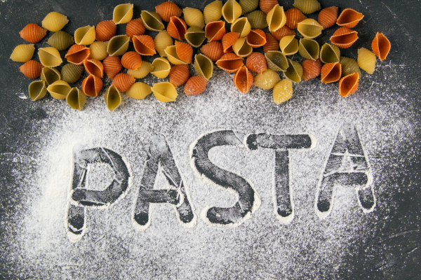 the words pasta drawn a finger