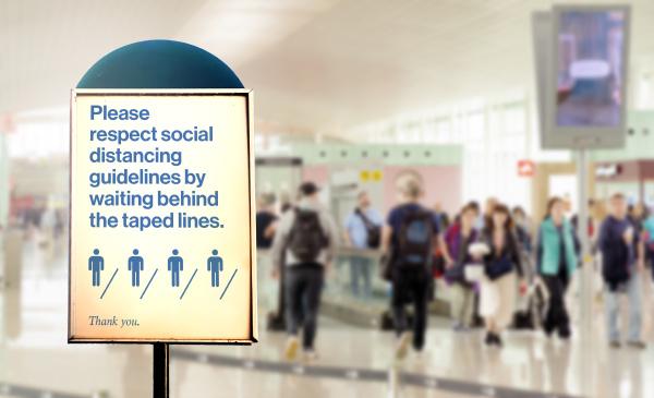 a sign inside an airport warns