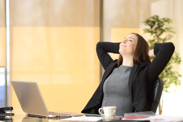 relaxed executive breathing fresh air at