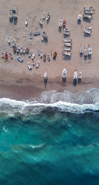 aerial view of many boats ashore