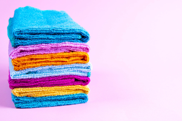 multi colored towels on a pink