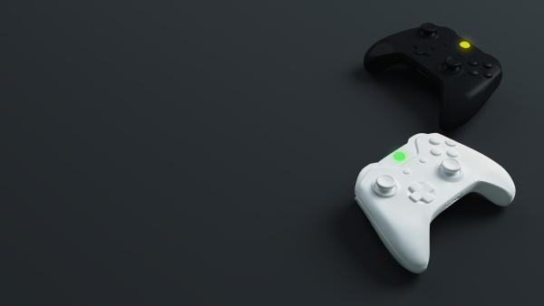 white and black joystick with dark