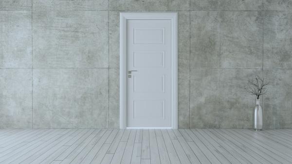 closed white door in empty room