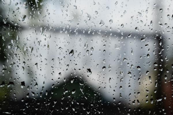 raindrops on window pane blurred