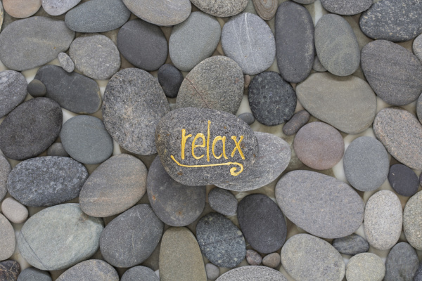 pebble with golden word relax