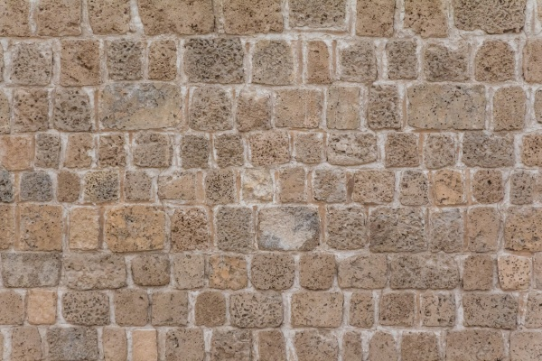 old stable stone wall with rows