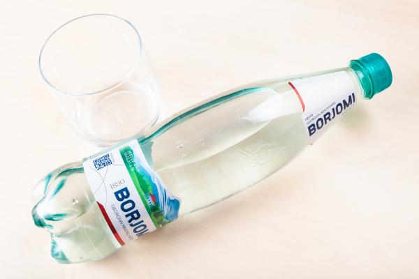 lying plastic bottle of borjomi and