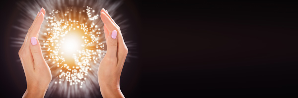 womans hand protecting light