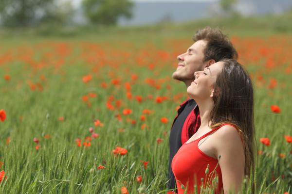 happy couple breathing fresh air on