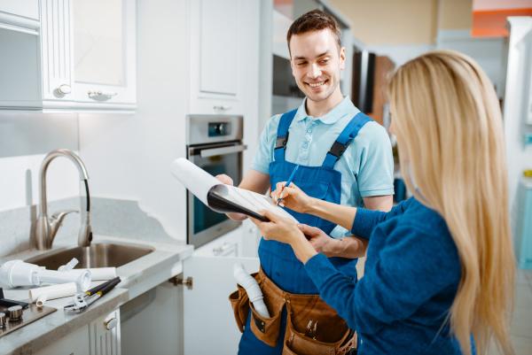 male plumber and female customer in