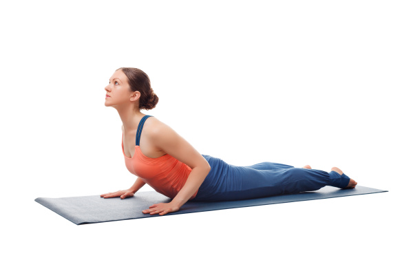 sporty fit yogini woman practices yoga