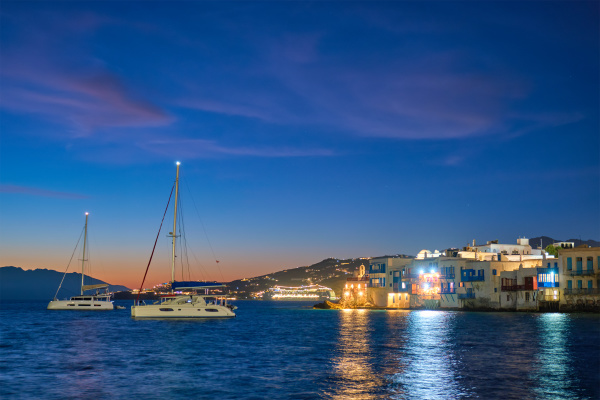 sunset in mykonos greece with cruise