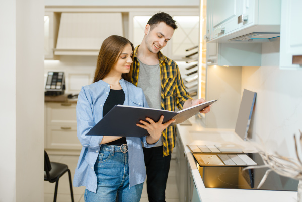 couple choosing kitchen garniture furniture store