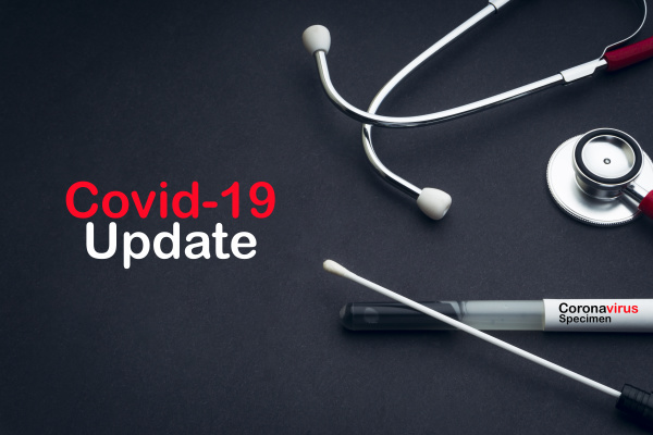 covid 19 update text with stethoscope