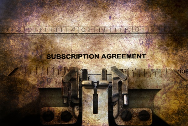 subscription agreement form on typewriter